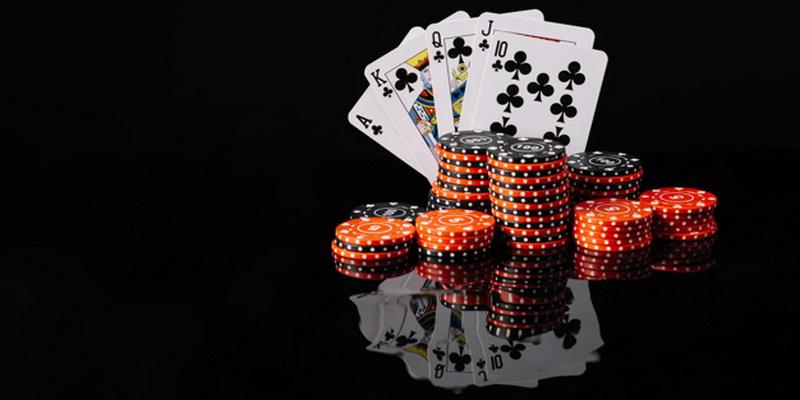 Royal flush and chips - 7 card stud poker hands